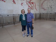 Ann and Greg in front of maps of landing